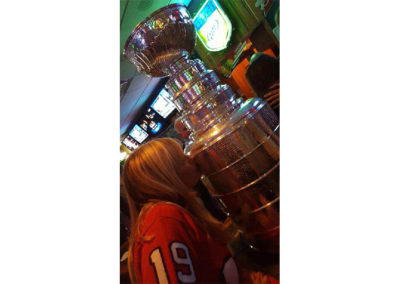Riley's Gathering Place | Debbie kissing the Stanley Cup